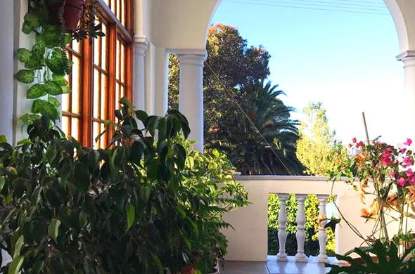View of the balcony and garden at Esperanza Guest House.